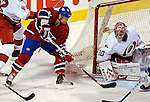 6 February 2007: Montreal Canadiens center Christopher Higgins (21) tries to get the puck past Carolina Hurricanes goaltender Cam Ward (30) at the Bell Centre in Montreal, Canada. The Hurricanes went on to defeat the Canadiens 2-1.....Mandatory Photo Credit: Ed Wolfstein *** Editorial Sales through Icon Sports Media *** www.iconsportsmedia.com