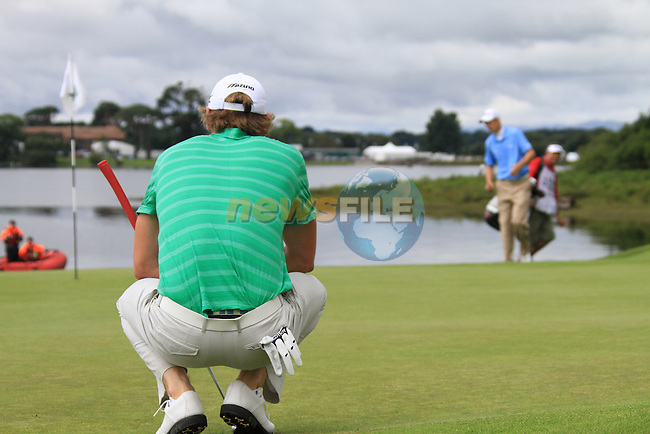 Chris Wood lines up his putt as Ross Fisher looks at his on the 4th green during the Final Day of the 3 Irish Open at the Killarney Golf & Fishing Club, 1st August 2010..(Picture Eoin Clarke/www.golffile.ie)