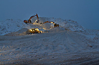 A Night at the Snow Farm<br /> Loaders and shovels work atop a 12-story-tall mountain of snow, cleared from the city's streets, at Boston's largest snow farm, South Boston, MA.