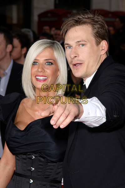 SAMMI MILLAR & LEE RYAN .World Premiere of 'The Heavy' at the Odeon West End, Leicester Square, London, England, UK. .April 15th 2010 .half length black tie suit white shirt waistcoat miller couple dress corset hand arm pointing .CAP/AH.©Adam Houghton/Capital Pictures.