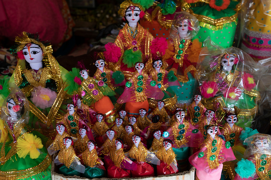 """India - Manipur - Imphal - Hand made dolls sold on a stall at Ima Market. <br /> <br /> Located in the centre of this laid-back city at the border with Myanmar, the Ima Keithel (or """"mo-ther's market"""" in local Meitei language) is the biggest market in the world run and managed exclu-sively by women. Around 10,000 of them work here every day, selling every kind of local product from, food to textiles, knives, toys and religious items."""