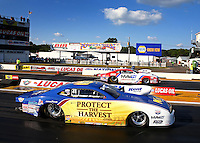 Aug. 16, 2013; Brainerd, MN, USA: NHRA pro stock driver Rodger Brogdon (near lane) races alongside Greg Stanfield during qualifying for the Lucas Oil Nationals at Brainerd International Raceway. Mandatory Credit: Mark J. Rebilas-