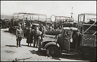 BNPS.co.uk (01202 558833)<br /> Pic: BNPS<br /> <br /> Officers stood in front of a fleet of burnt-out British army trucks which would have been used to off-load the thousands of the retreating troops days before.<br /> <br /> Haunting photos which capture the trail of devastation left in the wake of the Dunkirk evacuation have been unearthed after 77 years.<br /> <br /> The poignant pictures were taken soon after 330,000 Allied troops had been rescued from the beaches by an armada of little ships having been defeated by the Germans.<br /> <br /> The epic operation is about to be the subject of the new Hollywood blockbuster movie 'Dunkirk' will stars Tom Hardy and Harry Styles and is die for release on July 21.<br /> <br /> The black and white snaps show German soldiers surveying the wreckage which included destroyed ships and large military trucks lying in the surf.<br /> <br /> They are being sold by Duke's Auctioneers.