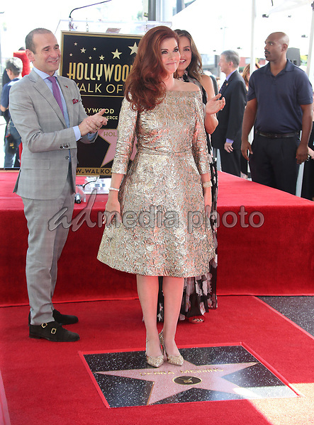 05 October 2017 - Hollywood, California - Debra Messing. Debra Messing Honored With Star On The Hollywood Walk Of Fame. Photo Credit: F. Sadou/AdMedia
