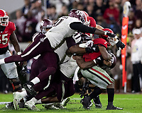 ATHENS, GA - NOVEMBER 23: Buddy Johnson #1, Justin Madubuike #52, DeMarvin Leal #8 and Micheal Clemons #91 of the Texas A