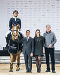 Yu An Su of Hong Kong riding Chardonay Hara Des Barrages poses for a photo with equestrian Ludger Beerbaum and Hong Kong Equestrian Federation President Michael Lee at the JETS Challenge during the Longines Masters of Hong Kong at AsiaWorld-Expo on 10 February 2018, in Hong Kong, Hong Kong. Photo by Diego Gonzalez / Power Sport Images