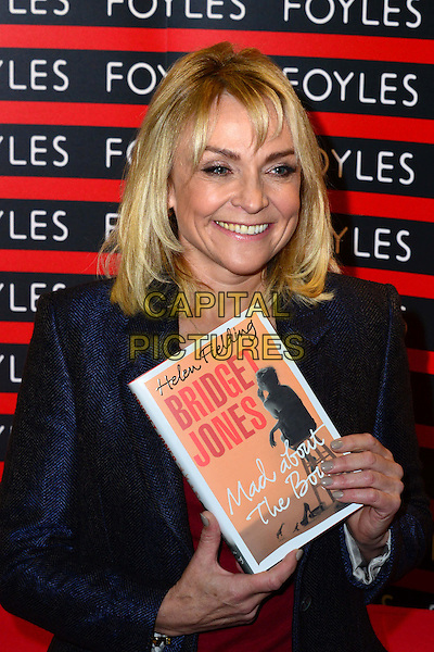 Helen Fielding Bestselling British novelist, renowned for her Bridget Jones books which were made into several hit films, signs copies of her new book, 'Bridget Jones: Mad About the Boy', set in the present day.  Foyles, Charing Cross Road, London, England.<br /> October 10th, 2013<br /> half length blue jacket coat red top <br /> CAP/BF<br /> &copy;Bob Fidgeon/Capital Pictures