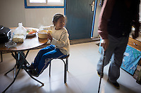 Granddaughter Dula of herder Renqima eats breakfast before going to school in Damao Banner, Inner Mongolia, China, October 2014.