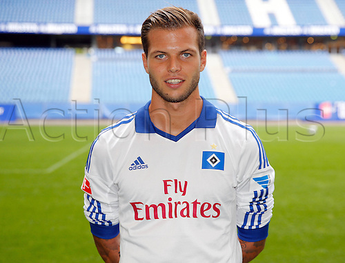 30.07.2013. Hamburg, Germany.  German Bundesliga soccer club Hamburger SV's Dennis Diekmeier poses during the official photo shoot for the season 2013-14 at Hamburg's Imtech Arena stadium.