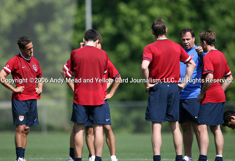 U.S. head coach Bruce Arena (in blue) talks with players during training on Sunday, May 14th, 2006 at SAS Soccer Park in Cary, North Carolina. The United States Men's National Soccer Team held a training session as part of their preparations for the upcoming 2006 FIFA World Cup Finals being held in Germany.