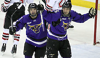 Minnesota State University-Mankato's John McInnis (left) and Eriah Hayes celebrate Hayes's power play goal during the second period. (Photo by Michelle Bishop)