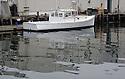 White lobster boat in Portland Maine harbor
