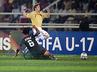 Zachary Herold (6) slide tackles Iker Muniain (7). Spain defeated the U.S. Under-17 Men National Team  2-1 at Sani Abacha Stadium in Kano, Nigeria on October 26, 2009.
