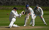 Aberdeenshire CC V Grange CC, Lloyds TSB Scottish Cup, played at Mannofield, Aberdeen - Grange batsman Cameron Coles (who went on to top-score for the Edinburgh side, on 95) hits out with 'Shire keeper Matthew Cross and fielder Neil MacRae looking for a slip - Picture by Donald MacLeod 21.06.09