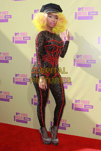 Nicki Minaj.The 2012 MTV Video Music Awards held at Staples Center in Los Angeles, California, USA..September 6th, 2012.VMA's VMAS VMA full length lace catsuit red sequins sequined detailing neon yellow pink hued hair hat silver shoes hand arm waving side .CAP/ADM/KB.©Kevan Brooks/AdMedia/Capital Pictures.