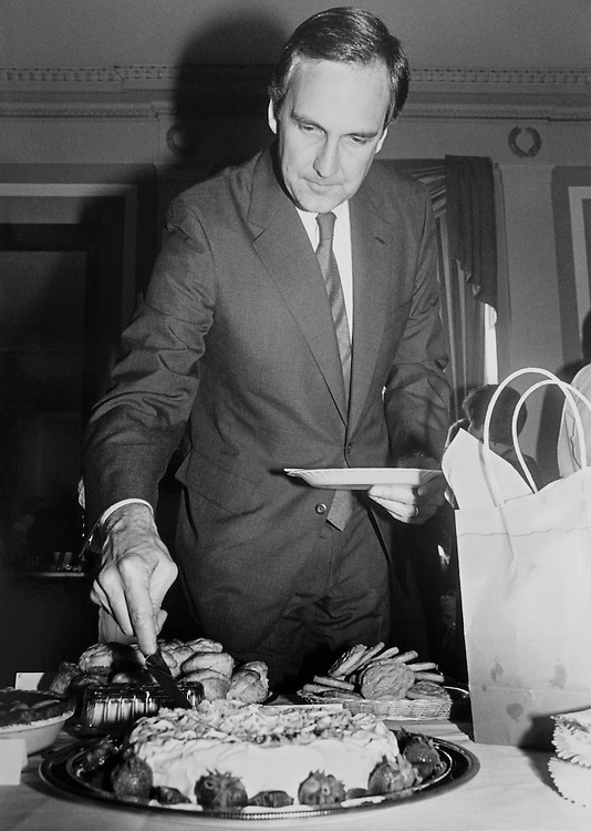 "Rep. Robert Linlithgow ""Bob"" Livingston, R- La., House Appropriations Committee Chair serving cake for himself. (Photo by CQ Roll Call)"