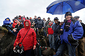 smiles despite the heavy rain - at the World Stone Skimming Championships which attracted over 300 entries from all round the world - Easdale is reached by a small open ferry-boat from the Isle of Seil - south of Oban - picture by Donald MacLeod - 25.9.11 - clanmacleod@btinternet.com 07702 319 738 donald-macleod.com