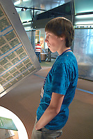A student visitor looks at an money exhibit at the Federal Reserve Bank Visitor Center, Chicago, Illinois (model released)
