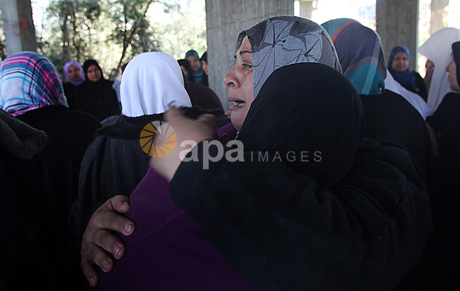 Palestinian mourners carry the body of 22-year-old Palestinian Odah Hamad during his funeral in Beit Hanoun in the northern Gaza Strip December 21, 2013. Israeli forces shot and killed a Palestinian, Hamad, and wounded three others in three separate incidents of cross-border violence in the Gaza Strip on Friday, Palestinian officials said. The Israeli military, which has long said the area in Gaza along the border fence is off limits, said it was looking into the reports. Photo by Yasser Qudih