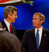Coral Gables, FL - September 30, 2004 -- United States President George W. Bush, right, shakes hands with his Democratic challenger United States Senator John F. Kerry (Democrat of Massachusetts) at the conclusion of the first of their three scheduled meetings at the University of Miami in Coral Gables, Florida on September 30, 2004. .Credit: Ron Sachs / CNP