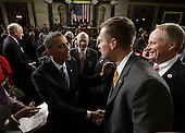 United States President Barack Obama shakes hands as he leaves after giving his State of the Union address during a joint session of Congress on Capitol Hill in Washington, DC on February 12, 2013.   .Credit: Charles Dharapak / Pool via CNP