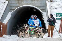 Jason Mackey's team comes through the tunnel under Gambell Street during the Ceremonial Start of the 2016 Iditarod in Anchorage, Alaska.  March 05, 2016