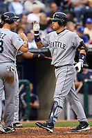 Mariners catcher Kenji Johjima is greeted at the plate by Raul Ibanez after hitting a grand slam in the fourth inning against the Royals at Kauffman Stadium in Kansas City, Missouri on May 26, 2007.  Seattle won 9-1.