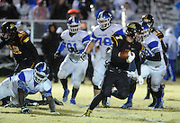 NWA Democrat-Gazette/ANDY SHUPE<br /> Sol Walker (7) of Prairie Grove carries the ball through the Star City defense Friday, Nov. 27, 2015, during the first half of play at Tiger Stadium in Prairie Grove. Visit nwadg.com/photos to see more photographs from the game.