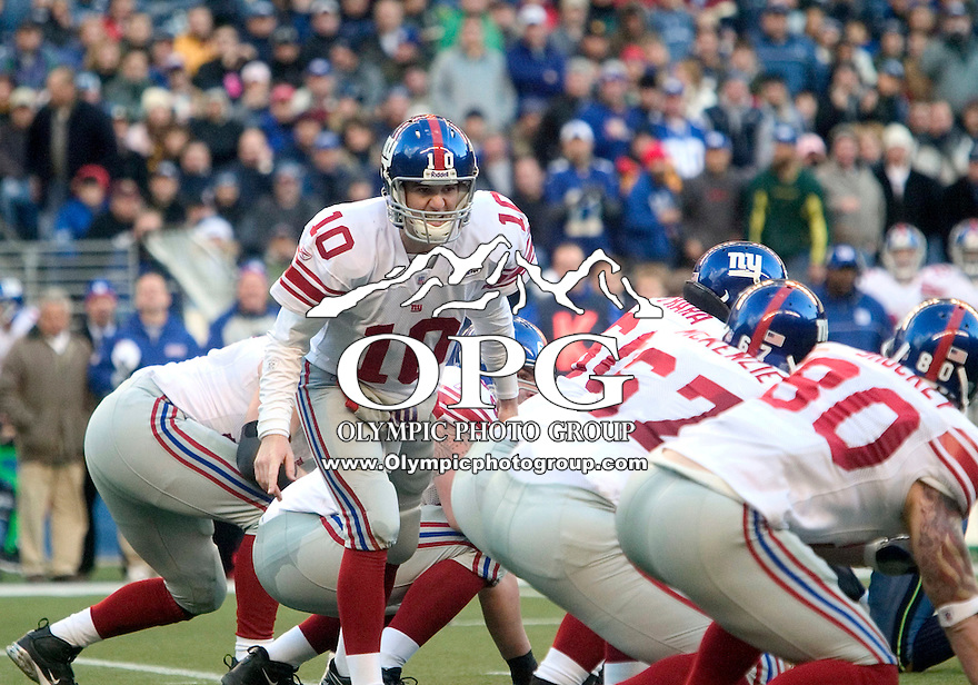 27 Nov 2005:   New York Giants quarterback Eli Manning calls out the play at the line of scrimmage against the Seattle Seahawks at Quest Field in Seattle, WA.