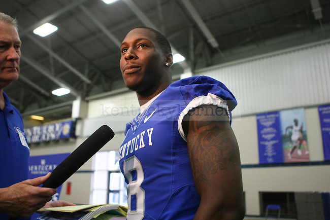 Wide receiver Javess Blue answers interview questions during UK football media day at Nutter Field House in Lexington, Ky., on Friday, August 8, 2014. Photo by Michael Reaves | Staff
