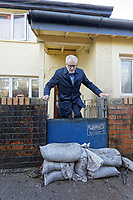 Pictured: Jeremy Corbyn climbs over a flood defence barrier, leaving the house of Theresa Davies which suffered flood damage. Thursday 20 February 2020<br /> Re: Jeremy Corbyn, the leader of the Labour Party visits the area of Rhydyfelin near Pontypridd, south Wales, UK.