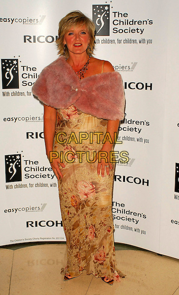 BERNIE NOLAN.The Children's Society annual ball, this year celebrating the society's 125th anniversary with a fairytale theme at Claridges Ballroom, London, UK..May 17th, 2006.Ref: CAN.full length gold floral print dress pink wrap stole fur.www.capitalpictures.com.sales@capitalpictures.com.©Capital Pictures