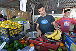 A man sells bananas in his small shop in a camp for internally displaced families in Ankawa, near Erbil, Iraq. Residents of the camp, mostly Christians, were displaced from Mosul, Qaraqosh and other communities in Iraq when ISIS swept through the area in 2014.