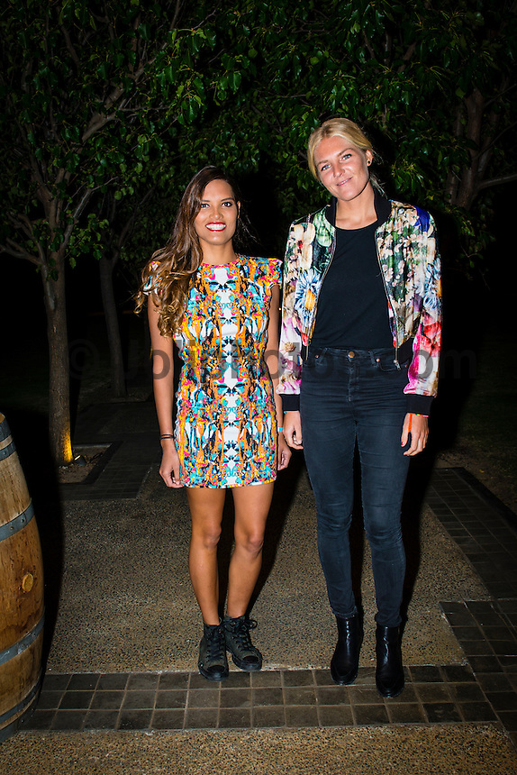 Margaret River, Western Australia (Saturday, March 23, 2013) Bridie McNevin (AUS) and Stephanie Gilmore (AUS) arrive at Xanadu Winery for the Sponors Dinner.- Day Seven of the Drug Aware Margaret River Pro was called on today with surf in the solid 10' plus range at the main break at Margaret River. .The remaining four heats of the No Loser Round of 24 were completer plus the whole of Round of 24. Dusty Payne (HAW) was the standout again today while Julian Wilson survived an interference call to defeat Kolohe Andino (USA) and move to the Quarter Finals..The Women's  and the Men's events will wrap up tomorrow..Stop No. 2 of 8 on the ASP Women's World Championship Tour, will see the 2013 Drug Aware Margaret River Pro play a vital role in deciding this year's ASP Women's World Champion. The men's Division carries an ASP PRIME rating and is the first event of that calibre this year and the field of 96 of the world's best surfers are keen to set themselves up as front runners for 2014 ASP WCT qualification..Photo: joliphotos.com