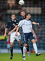 Forfar's Gavin Swankie goes up with Dundee's Jim McAlister and Dundee's Willie Dyer.