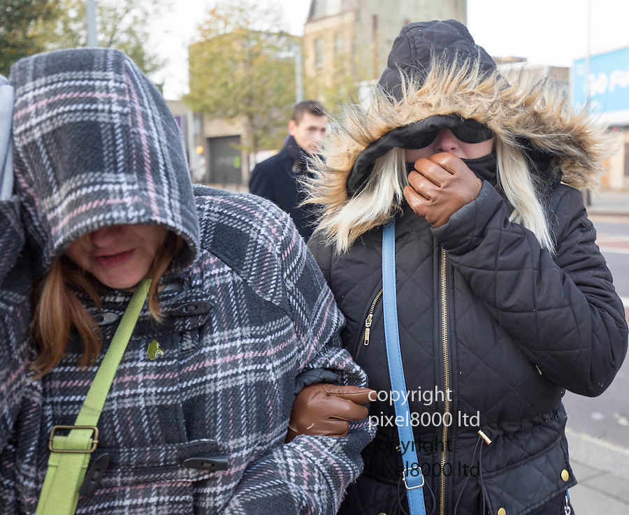pic shows: Jacqueline Patrick, left and daughter, Katherine arrive at Inner London Crown Court for sentencing today. 23.11.15<br /> <br /> They tried to cover their faces with hoods and screamed abuse at waiting media.<br /> <br /> A woman has admitted trying to murder her husband by poisoning him with anti-freeze concealed in a Christmas drink of cherry Lambrini.<br /> Jacqueline Patrick, 54, of Durning Road, Norwood, south-east London, pleaded guilty to two counts of attempted murder on her husband Douglas, 70.<br /> Their daughter Katherine, 21, admitted encouraging an indictable offence.<br /> Family arguments were believed to have motivated the pair, police said.<br /> <br /> <br /> <br /> <br /> Pic by Gavin Rodgers/Pixel 8000 Ltd