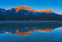 Sunrise on the Canadian Rocky Mountains reflected in the Athabasca River. Icefields Parkway.<br />