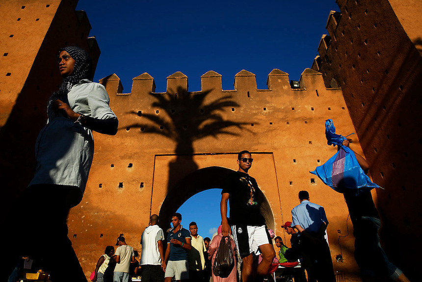 "People walk through Bab el Had gates of Rabat's Medina September 21, 2014. Behind walls of Medina and Kasbah of the Oudayas, ancient neighbourhoods of Morocco's capital, labyrinths of small alleys, colourful buildings and street markets offer a glimpse into city's rich history. Rabat was recently listed by UNESCO as a World Heritage Site and suggested as a ""must see"" destination by major media outlets and tourist agencies.  REUTERS/Damir Sagolj (MOROCCO)"