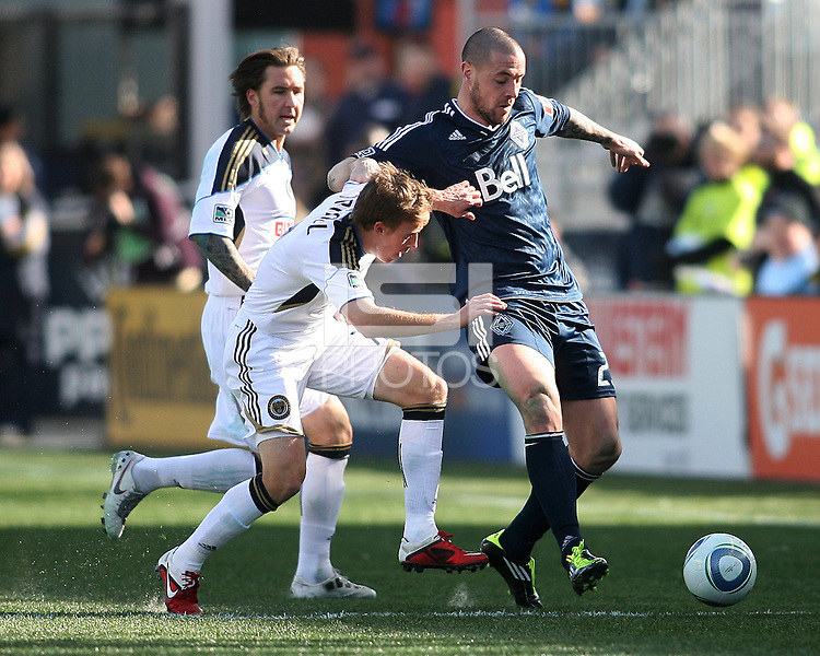 Brian Carroll#7 of the Philadelphia Union tackles Eric Hassli#29 of the Vancouver Whitecaps during an MLS match at PPL Park in Chester, PA. on March 26 2011. Union won 1-0.