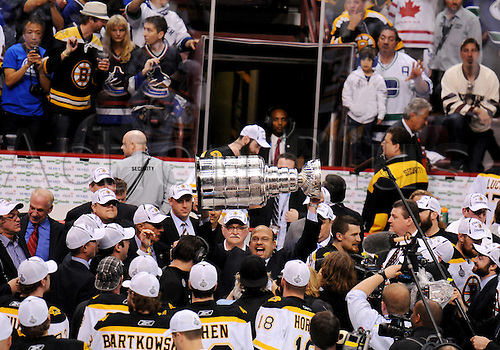 15.06.2011 The Stanley Cup is passed between members of the Boston Bruins organization after the Bruins defeated the Vancouver Canucks in game 7 of the Stanley Cup Finals at Rogers Arena in Vancouver, British Columbia on Wednesday night.