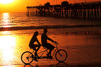 Couple Riding Bike At Sunset