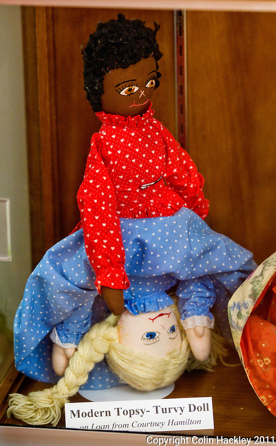 UPSIDE DOWN: A Topsy Turvy Doll features the torsos of an African American or a caucasian girl depending on which way it is turned. The doll is on display in the Slavery in the Old South collection of The Black Archives in Tallahassee..COLIN HACKLEY PHOTO