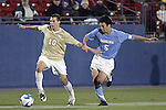 12 December 2008: Corben Bone (10) of Wake Forest shields the ball from Michael Callahan (5) of North Carolina.  The Wake Forest University Demon Deacons were defeated by the University of North Carolina Tar Heels 0-1 at Pizza Hut Park in Frisco, TX in an NCAA Division I Men's College Cup semifinal game.