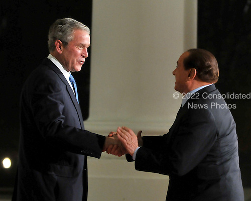 Washington, D.C. - November 14, 2008 -- United States President George W. Bush welcomes President Silvio Berlusconi of Italy to the Summit on Financial Markets and the World Economy on the North Portico of the White House in Washington, D.C. on Friday, November 14, 2008..Credit: Ron Sachs / Pool via CNP
