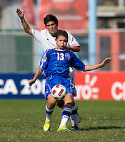 Alejandro Guido (10) of the United States tries to contain Romel Meija (13) of El Salvador during the quarterfinals of the CONCACAF Men's Under 17 Championship at Catherine Hall Stadium in Montego Bay, Jamaica. The USA defeated El Salvador, 3-2, in overtime.