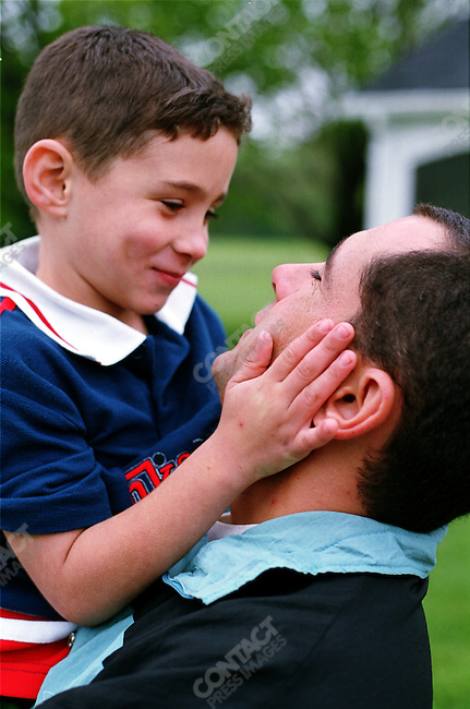 Elian Gonzalez with his father Juan Migel Gonzalez, at the Wye River Plantation, Maryland, April 27, 2000