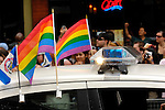Colorful rainbow flags on a police car at gay and lesbian Pride parade in Toronto Canada 2008