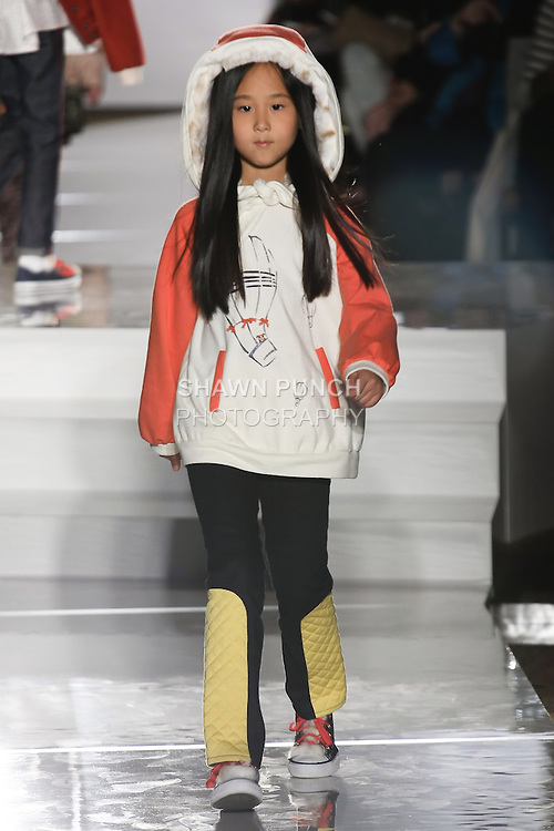 Model walks runway in an outfit by Jessica Klinger, for the Parsons 2011 BFA Fashion Show, hosted by Reed Krakoff.