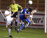 Frankie Hejduk collides with an El Salvador forward while heading the ball in San Salvador, El Salvador, Saturday Oct. 9, 2004. USA won 2-0.