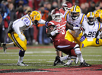 NWA Media/ J.T. Wampler -  Arkansas' Alex Collins gets swarmed by LSU defenders during the second quarter Saturday Nov. 15, 2014 at Donald W. Reynolds Razorback Stadium.